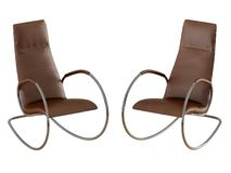 Two brown rocking chair on a white background 3d rendering. Two brown rocking chair on a white background 3d royalty free illustration