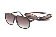 Two brown sunglasses on white. Two brown fashion sunglasses on white background Stock Photography