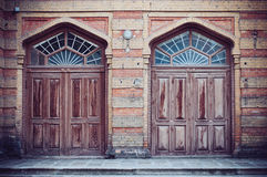 Two brown wooden doors Stock Photography