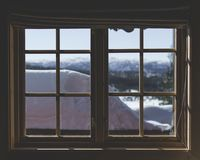 Two Brown Wooden Framed 6-lite Window Panes Royalty Free Stock Photo