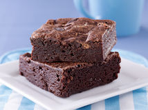 Two brownies stacked on a plate. Royalty Free Stock Images