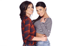Two Brunette Girls in Casual Clothes Posing Royalty Free Stock Photos