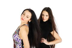 Two brunette girls look at camera Royalty Free Stock Photography