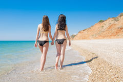 Two brunette at the sea Stock Photo