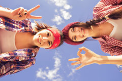 Free Two Brunette Teenage Girls Friends In Hipster Outfit (jeans Shorts, Keds, Plaid Shirt, Hat) With A Skateboard At The Park Outdoors Royalty Free Stock Images - 47955779