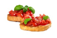 Two bruschetta with fresh tomato and basil Royalty Free Stock Photo