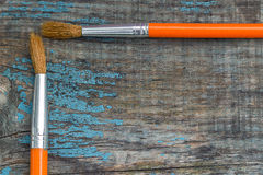 Two brushes on the background of the old wooden boards Stock Images