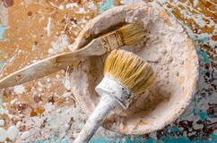 Brushes in a bowl with a putty Stock Image