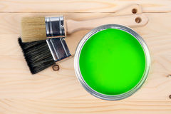 Two brushes and green paint bucket Royalty Free Stock Photography