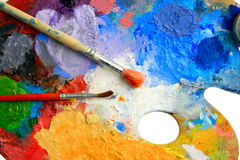 Two Brushes lay on an art palette Royalty Free Stock Images