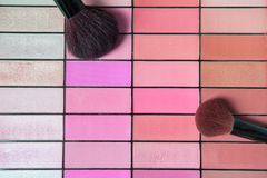 Two brushes on make up palette. With pink color on palate royalty free stock photos