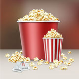 Two buckets of popcorn. Vector two white and red striped buckets of popcorn kernels with cinema tickets close up side view on blur background Stock Image