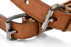 Two Buckles. Two brown leathers belts isolated on a white background Stock Image