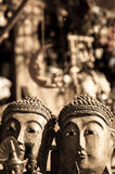 Two buddha heads in sepia Royalty Free Stock Photo