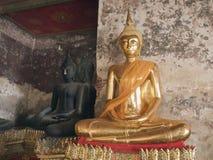 Two Buddha statues. Golden Buddha statues , Wat Suthat Bangkok Thailand Royalty Free Stock Image