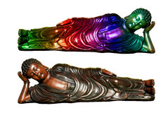 Two Buddha statues. Buddha statues one colorful and the the polished wood. Isolated against a white background with clipping path Royalty Free Stock Photos