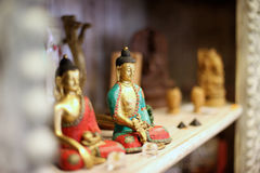 Two Buddha statues as souvenirs Stock Photography