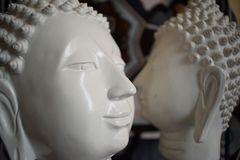 Two Buddha statues. On the opposite side Royalty Free Stock Image