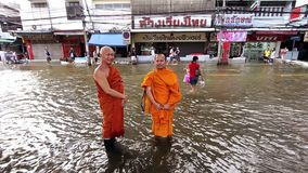 Two Buddhist monks in flood. In Bangkok, Thailand stock footage