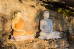 Two buddhist statues near the mountain royalty free stock photography