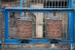 Small Buddhist Stupa Prayer Wheels in Kathmandu, Nepal. These are two Buddhist stupa prayer wheels in a blue metal frame in Kathmandu, Nepal royalty free stock photo