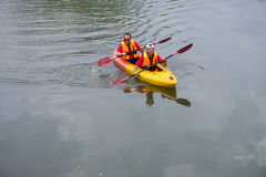 Two buddies paddling in a kayak Stock Photography