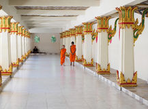 Two Buddist novice monks walking along the corridor of the temple Stock Photo
