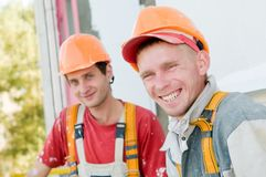 Two builder facade painters. Two happy smiling builder workers facade painters Royalty Free Stock Photos