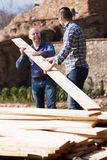 Two builders carrying over plane Royalty Free Stock Image