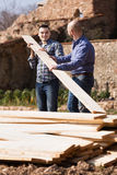 Two builders carrying over plane Royalty Free Stock Photo