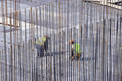 Two builders check of the construction. Royalty Free Stock Photography