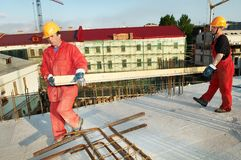 Two builders at construction site Royalty Free Stock Photo