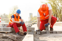 Two builders on construction site Stock Image