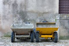 Two builders dumper trucks side by side Royalty Free Stock Images