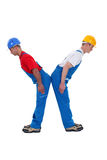 Two builders forming the letter X Royalty Free Stock Photos