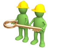 Two builders, holding in hands a gold key Royalty Free Stock Image