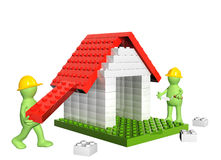 Two builders and house from 3d plastic toy blocks Stock Images