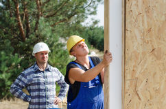 Two builders installing insulated wall panels Royalty Free Stock Photography