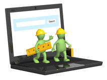 Two builders and laptop Royalty Free Stock Photos