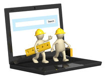 Two builders and laptop Stock Photo