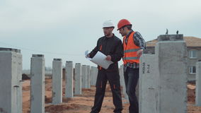 Two builders on site stock video footage