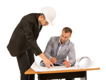 Two building contractors discussing a blueprint Royalty Free Stock Image