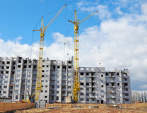 Two Building Cranes and Building High Rise with Copy Space. Stock Image