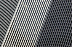 Two Buildings. An abstract perspective on two skyscrapers forms a series of parallel diagonal lines Stock Photo
