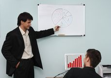 Two buisnessmen discussing the growth diagram royalty free stock photo