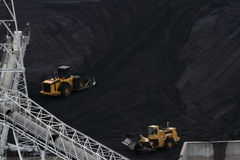 Two Bulldozer Moving Coal Stock Images
