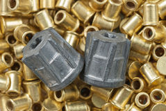 Two bullets and hunting primers Royalty Free Stock Images