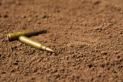 Two bullets, machine gun bullets on soil Stock Photography