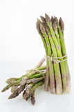 Two bunches of asparagus tied with raffia cord Stock Photos