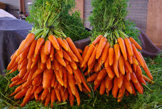 Two bunches of carrots. At the vegetables market Royalty Free Stock Photo
